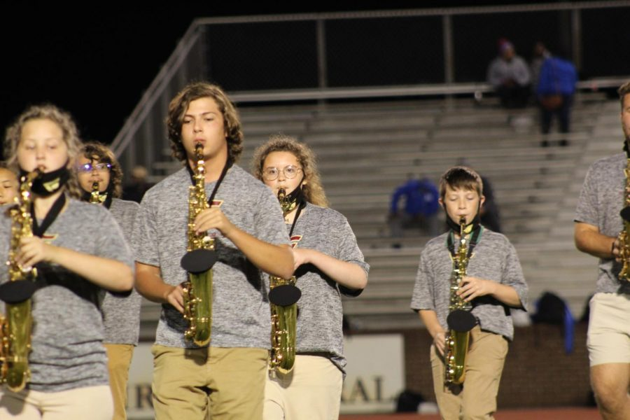 Members of the GCHS Pride band perform throughout the halftime of a Rebel football game.