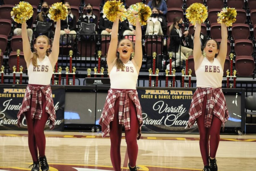 Dance team performs on the sidelines of a basketball game, but they also began dancing on the sides of football games earlier this year.