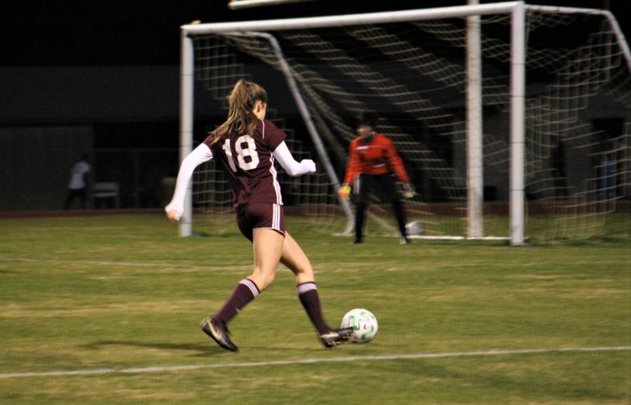 Riley Davis takes a shot on goal.