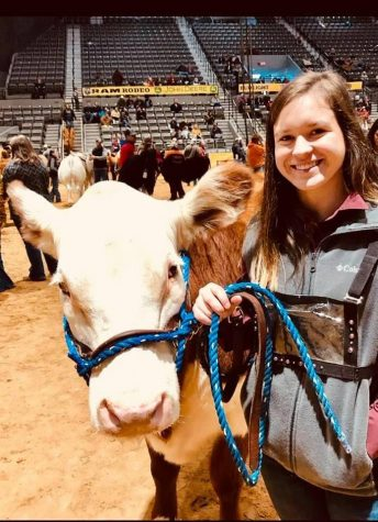 Aleigha Eubanks and her cow Ellie attend Dixie Nationals Rodeo in Jackson.