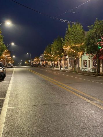 Main Street of Lucedale illuminating at night.