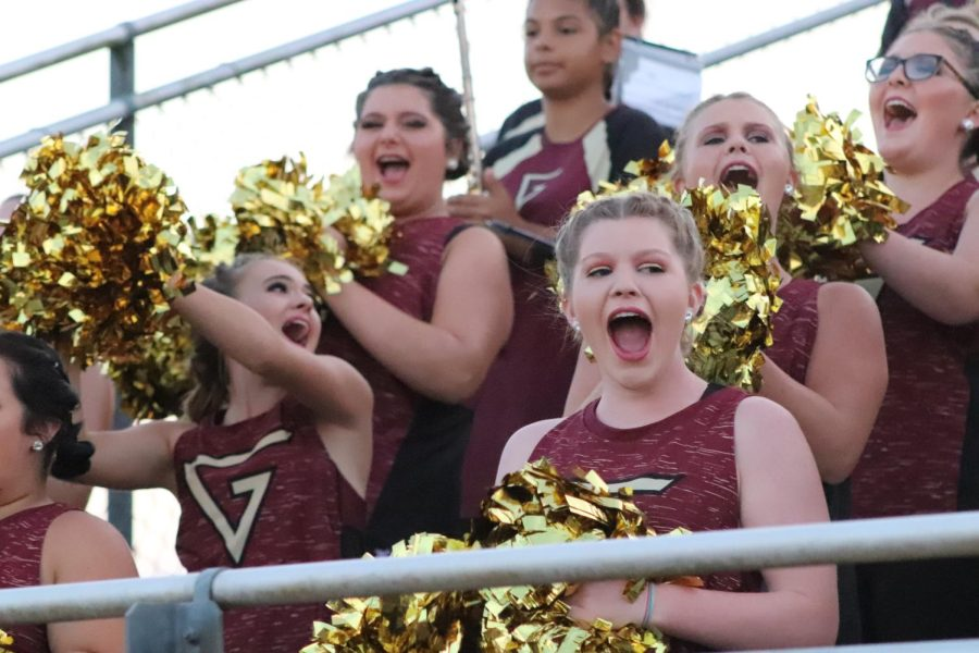 Band peps up the team at a football game.