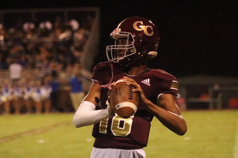Deuce Knight prepares to throw the ball to teammate.