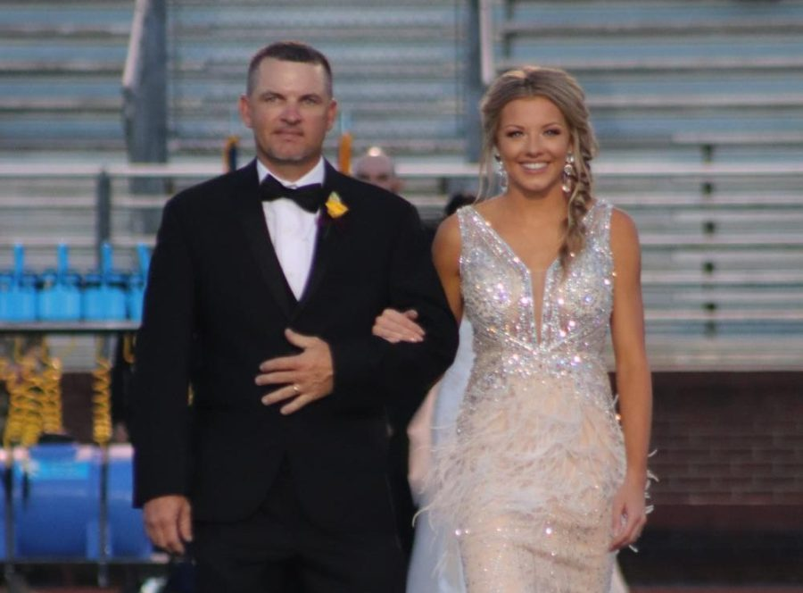 Senior Jacie Bounds escorted by Ryan Bounds