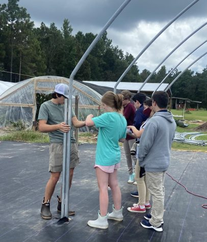 Horticulture students, Ava Rainey, Kage Eubanks and Chasen Brewer rebuild greenhouses.